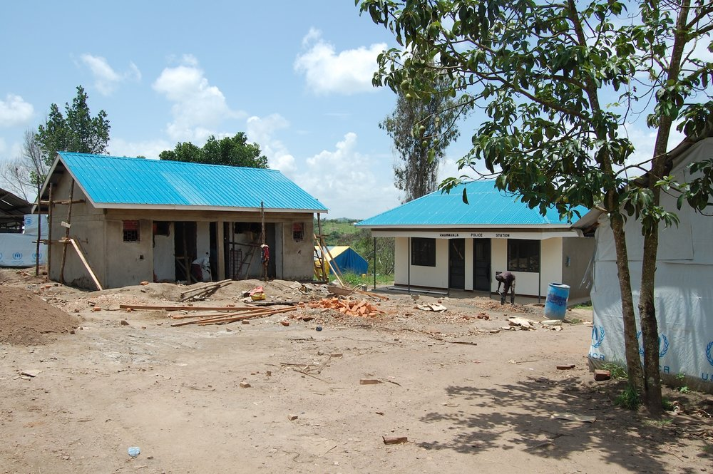 Construction of staff accomodation and a police station in Rwamwanja. Over 120 NGO, UN and Ugandan government personnel are currently living in the settlement. The police station will help provide security for the 36000 refugees as well as for the local host population. Picture: Andy Wheatley/DFID  By DFID - UK Department for International Development - Providing policing and protection for refugees, aid workers and the local population, CC BY 2.0,  https://commons.wikimedia.org/w/index.php?curid=30786736