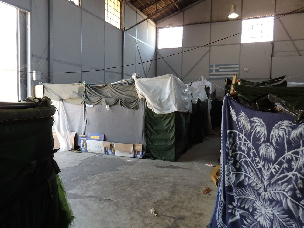Interior of the main building of the Thessaloniki port refugee camp  By Sorneguer - Own work, CC BY-SA 4.0,  https://commons.wikimedia.org/w/index.php?curid=49822723