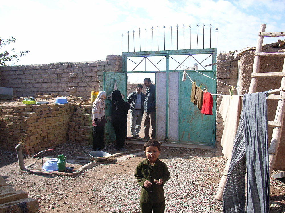 This house has piped water supply. The tap can be seen to the left. The used water is directed out under the gate where it flows into the drainage channel flowing outside. (Photo: Nov. 2009, N. Khawaja, Herat)  By SuSanA Secretariat -  https://www.flickr.com/photos/gtzecosan/4362399842/ , CC BY 2.0,  https://commons.wikimedia.org/w/index.php?curid=36535206