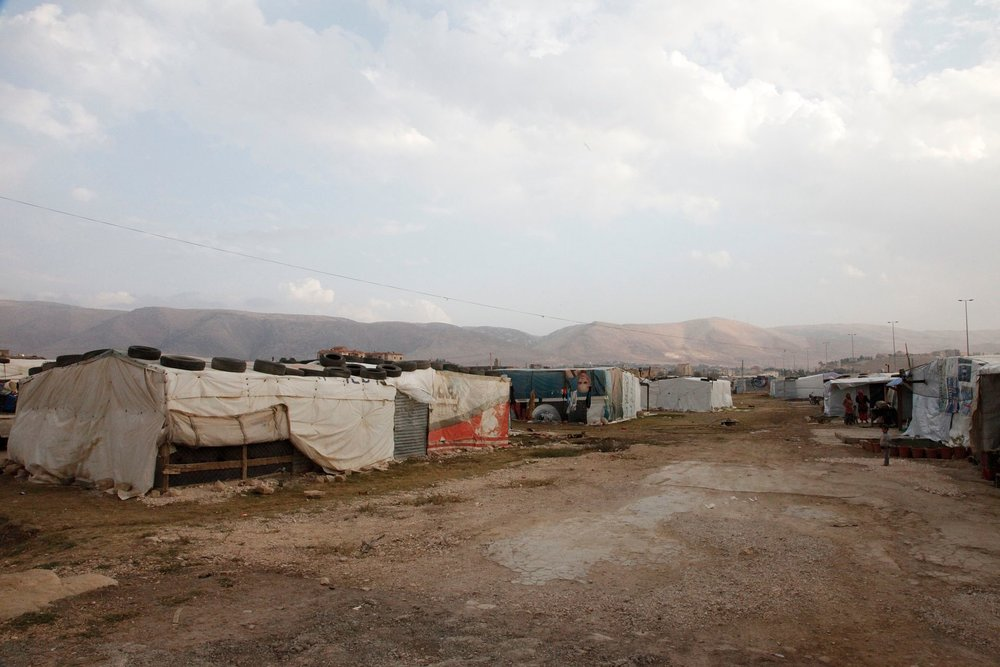 More details An 'informal tented settlement' in Lebanon's Bekaa valley. The mountains in the background form the border with Syria, just a few miles away. Millions of Syrian children face their worst winter yet as worsening weather and crowded refugee camps create the ideal conditions for the spread of life-threatening diseases such as pneumonia. The UK will provide winter tents, warm clothing and heaters as part of an allocation of nearly £90 million to help hundreds of thousands of Syrians, especially children, cope with the onset of winter. There are over 800,000 Syrian refugees in Lebanon now - 400,000 of whom are children. For full details on how the UK is helping people affected by the conflict in Syria, please see:  www.gov.uk/government/news/syria-the-latest-updates-on-uk ... Picture: Russell Watkins/Department for International Development