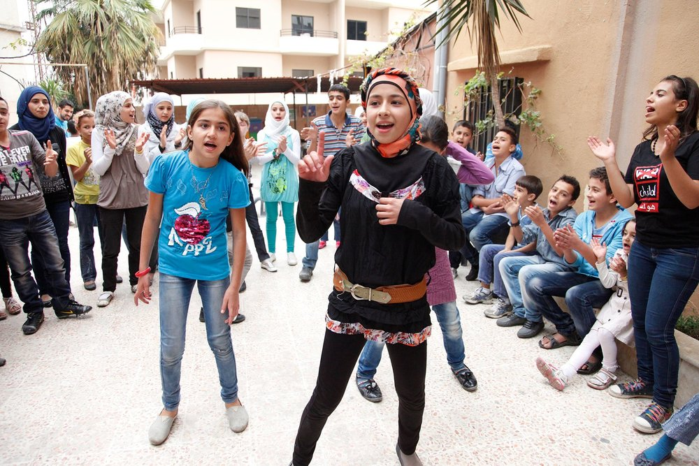 By DFID - UK Department for International Development - Dancing and singing to forget the pain of Syria's conflict, CC BY 2.0,  https://commons.wikimedia.org/w/index.php?curid=30786520