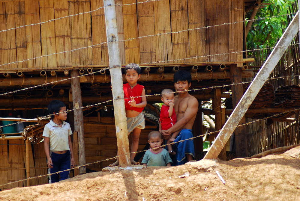 Mae La refugee camp in Thailand, home to around 50,000 refugees from Myanmar/Burma. Crossing the fence is illegal.  By Mikhail Esteves from Bangalore, India - Mae La Refugee Camp, CC BY 2.0,  https://commons.wikimedia.org/w/index.php?curid=2720844