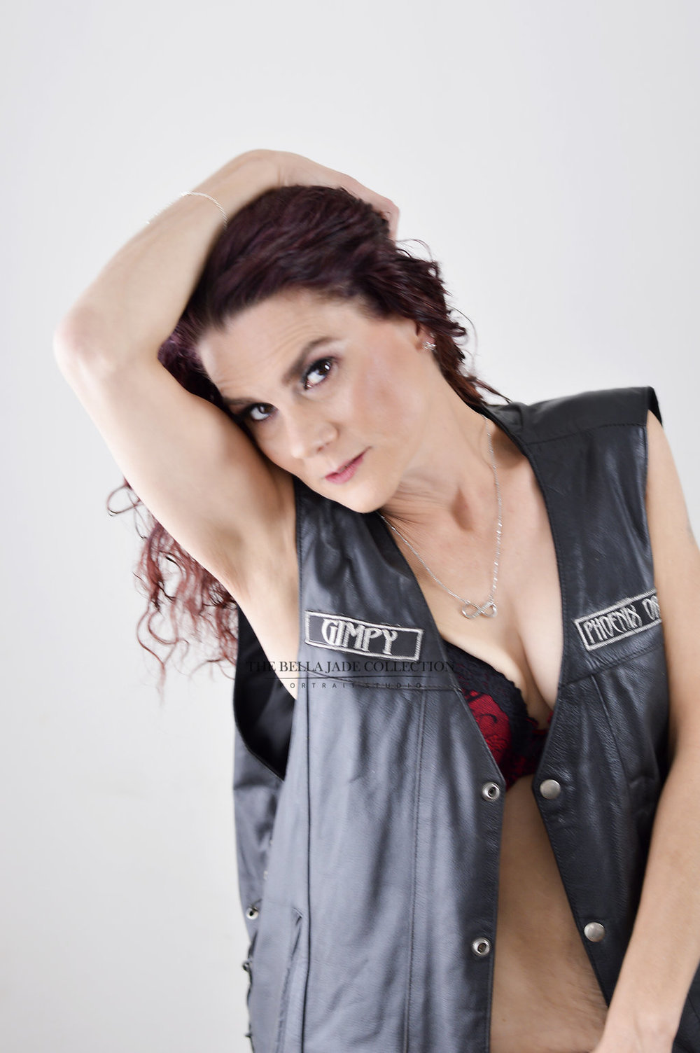 boudoir-picture-of-woman-in-leather-vest