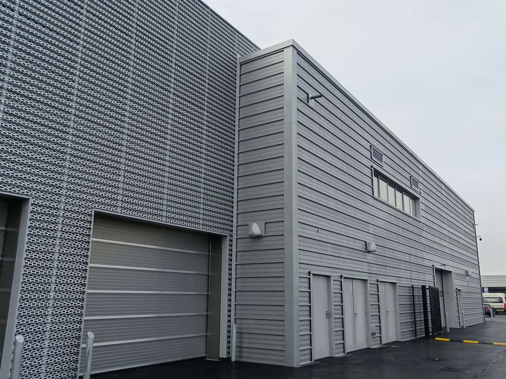 EDM Spanwall anodised aluminium perforated rainscreen cladding and Kingspan composite horizontal wall cladding