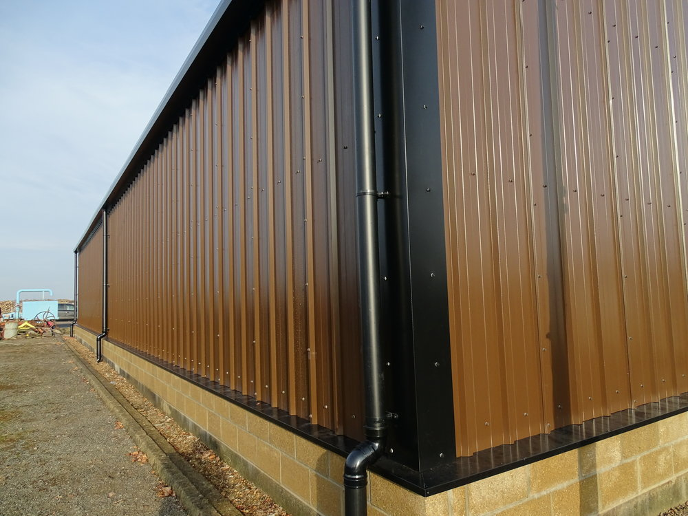Tata Steel & Profiles vertical composite wall cladding, external streamline guttering and PVCu downpipe