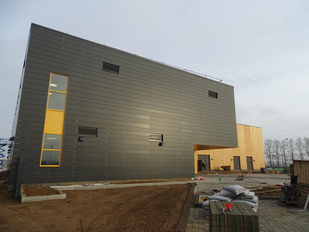 Rockpanel Rockclad rainscreen panels on an aluminium framing system to walls of sports hall