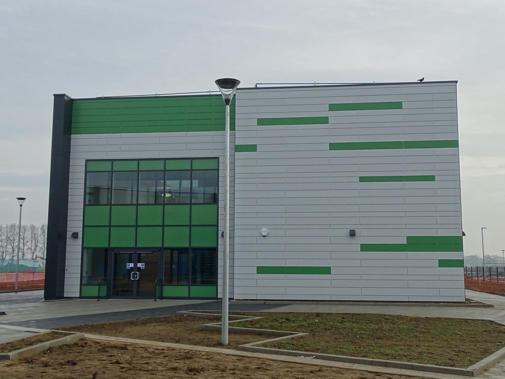 Rockpanel Rockclad rainscreen panels on an aluminium framing system to walls