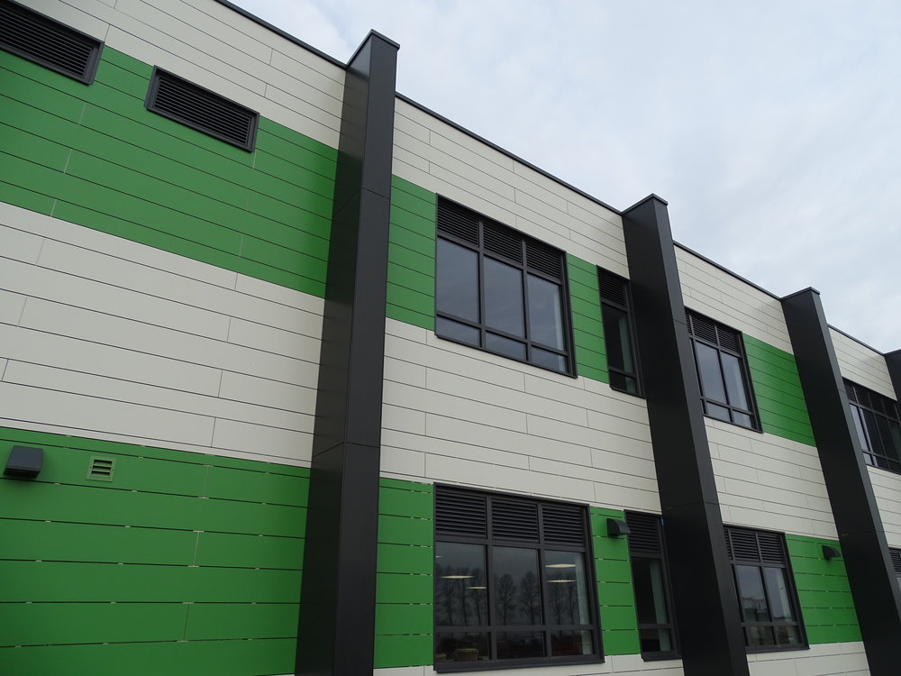 Rockpanel Rockclad rainscreen panels on an aluminium framing system to walls and columns