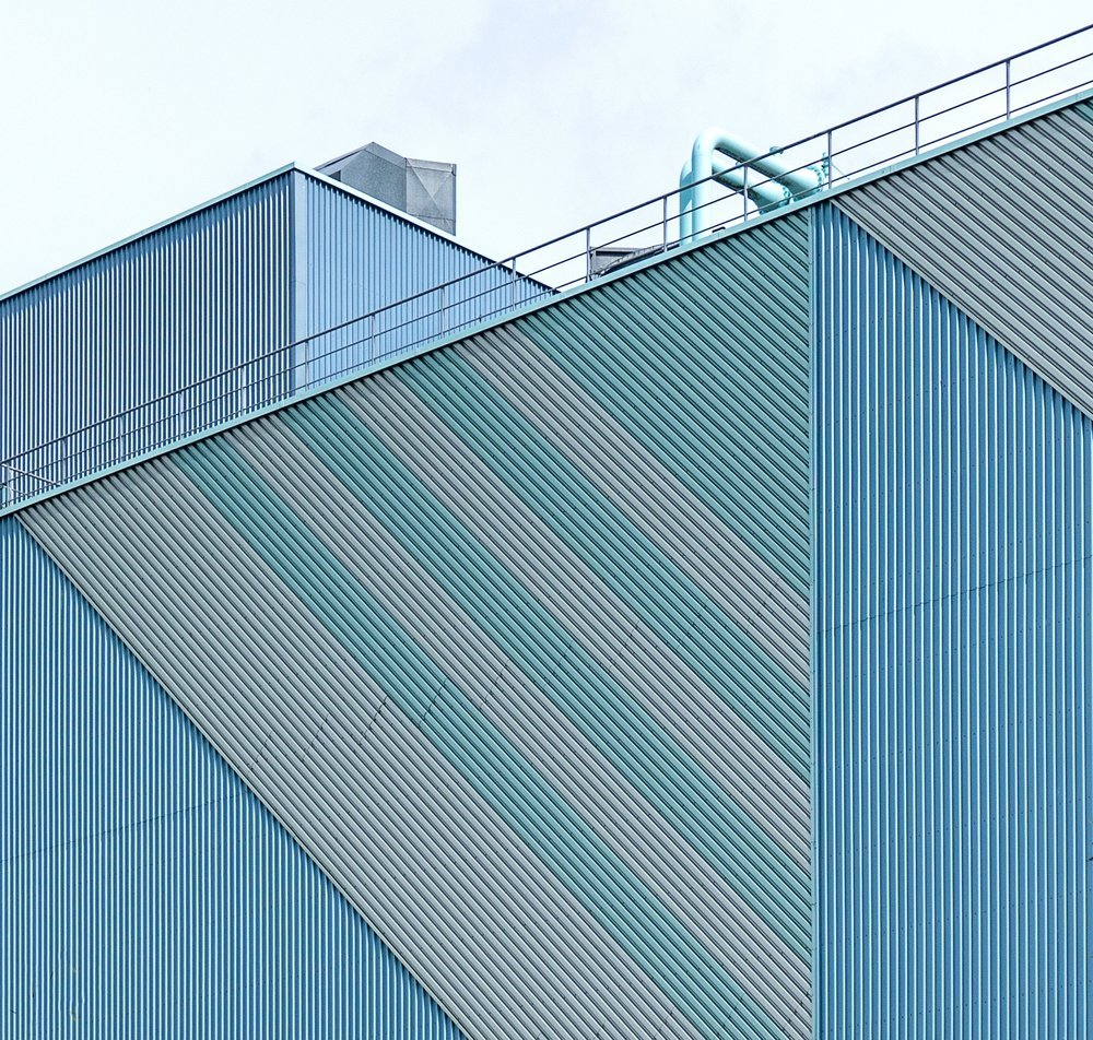 Twin-Skin Built Up  - Twin-Skin Cladding applications are used where an insulated system is required, often to improve the efficiency of the building. Twin skin systems are used in a wide range of buildings and situations from warehousing and industrial applications to office and showrooms.
