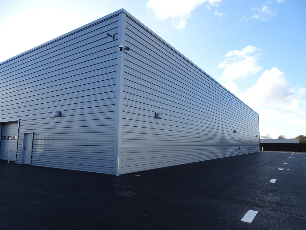 Composite Wall Systems  - This is a cost effective 'pre-layered' wall cladding system which includes the lining, insulation and top sheet all in one panel.The composite panels are available in a wide range of coatings and insulation thicknesses. They also have guaranteed structural & thermal performanceComposite systems are ideally suited for commercial and industrial projects delivering a fast and economical installation.The lower weight will typically result in a lower cost sub-structure and structural support system.