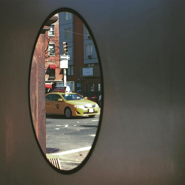 Peek at the City.  #nyc #cab #newyork #yellow #yellowcab #newyorkcity #lowereastside #brunch #window #restaurant #morning #weekend #gettaway #manhattan #streets #circle #frosted #mini #vacation #saxonandparole  #food and #cocktails #packaccordingly