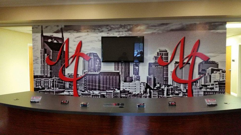 Interior branded wall graphics to display company branding and create a personal environment.