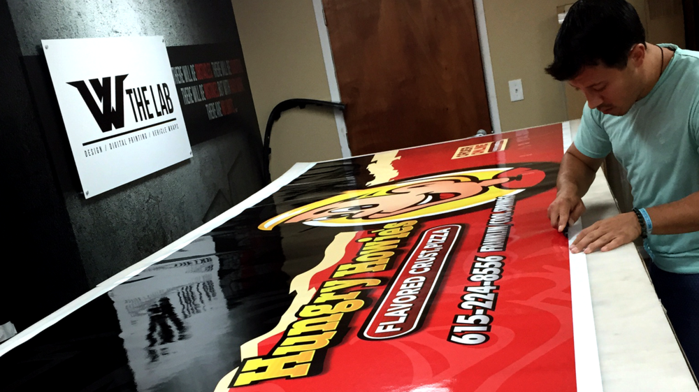 Prepping advertising wraps for Hungry Howie's in Franklin, TN.