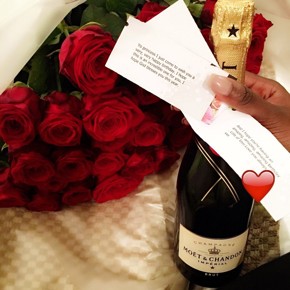 "These beautiful roses were in my room awaiting my arrival along with this champagne and stormzy's ""birthday girl"" lyrics on the tags. 27 Roses for my 27th."