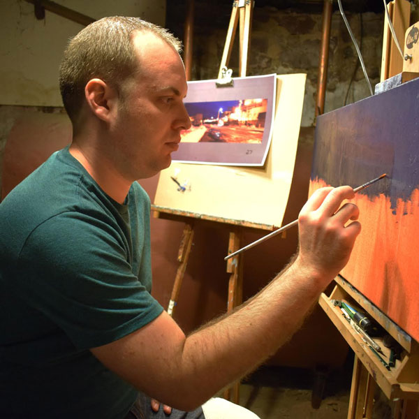 Patrick Seufert painting in his studio