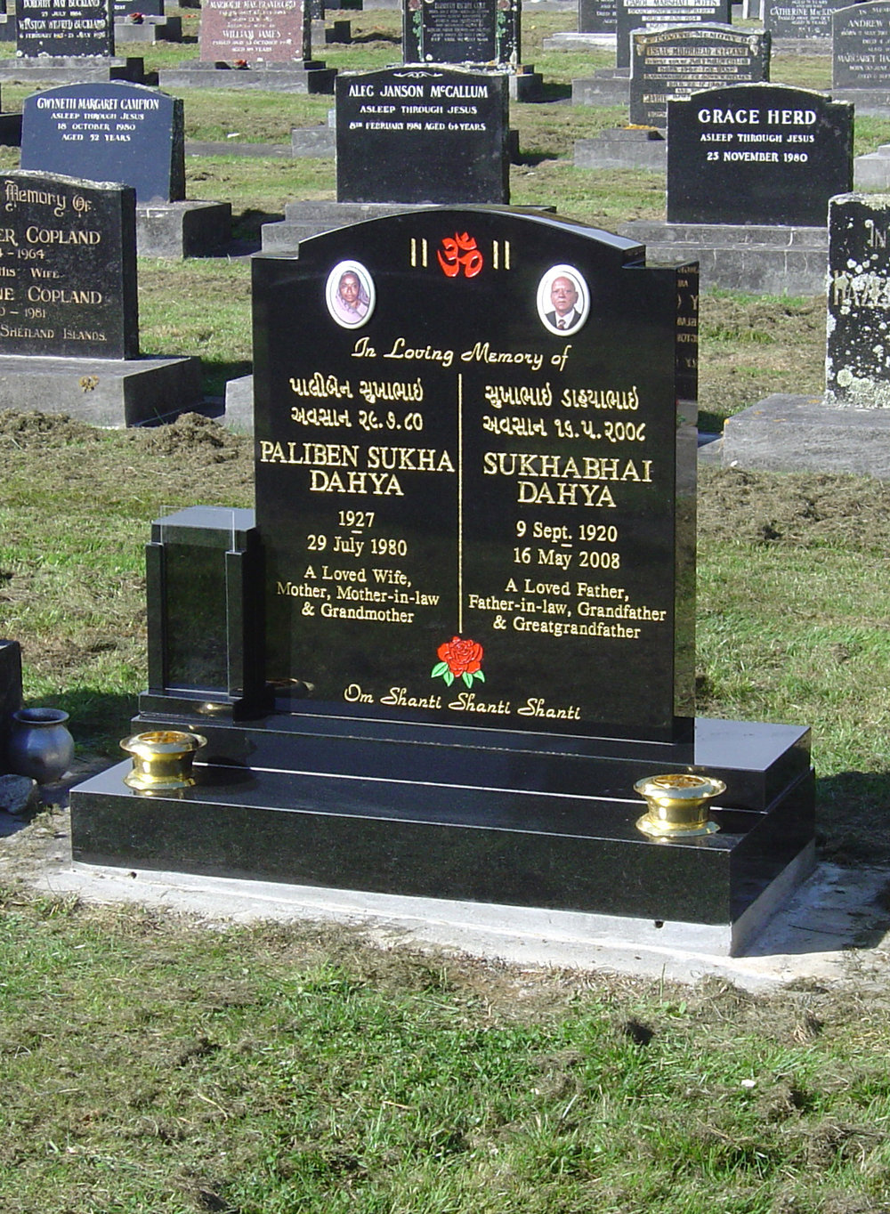 Black granite headstone, Indian custom design, 23 carat gold leaf lettering
