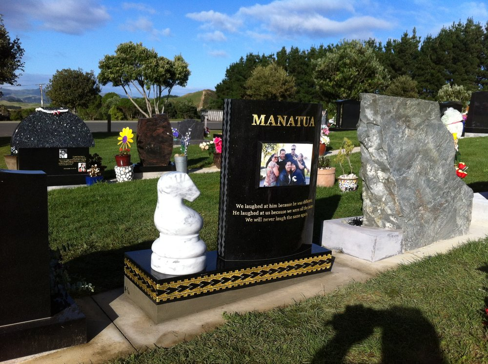 Black Granite. Monument. Curved Headstone. Carrara Marble Chess Piece. Custom Tapa design.JPG