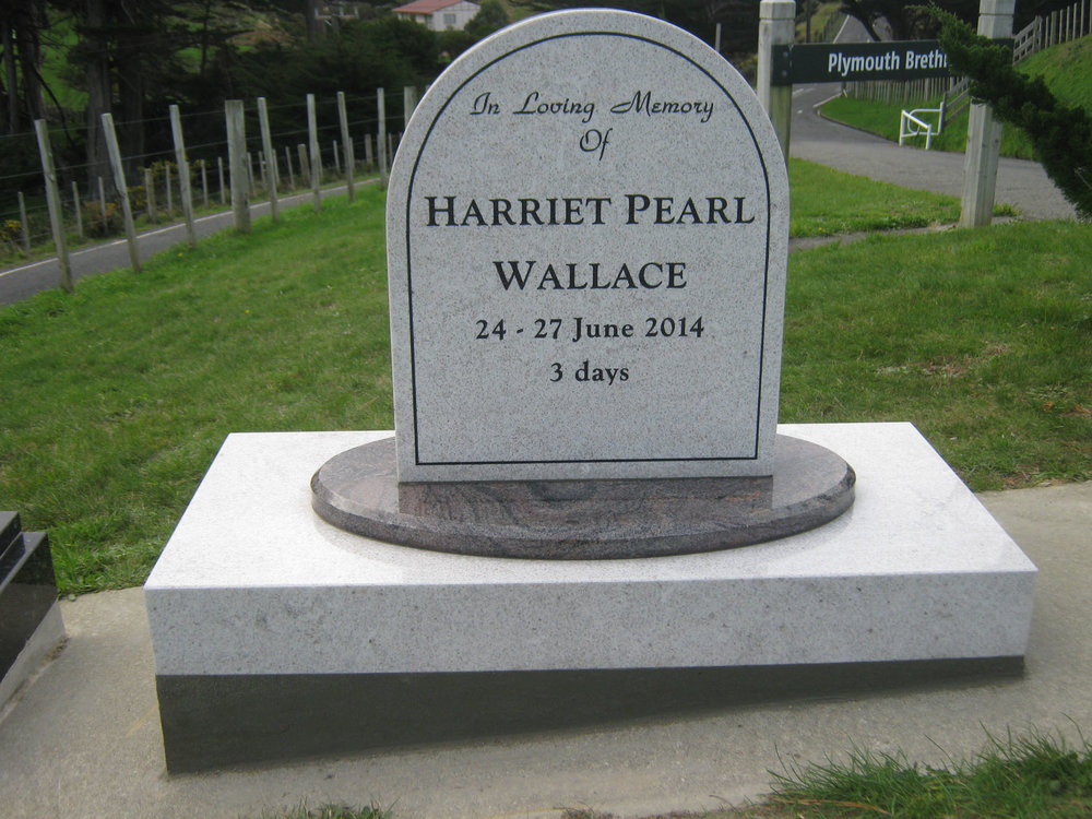 White Pearl Round top headstone.jpg