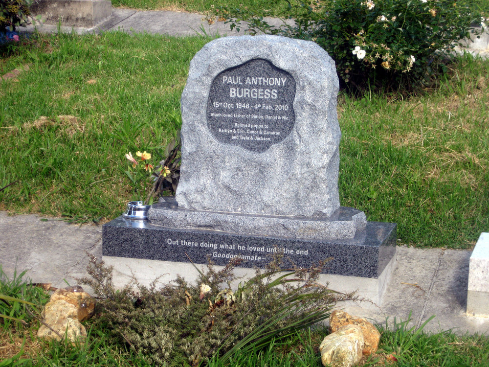 Grey granite custom designed headstone made from a boulder
