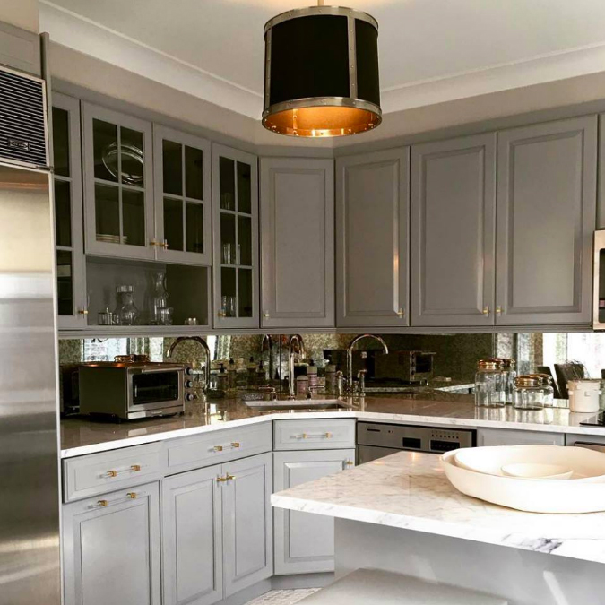 Shades of chic neutrals (with our Ipswich pendant light) in a NYC kitchen by #SamAllenInteriors. #WaterworksKitchen