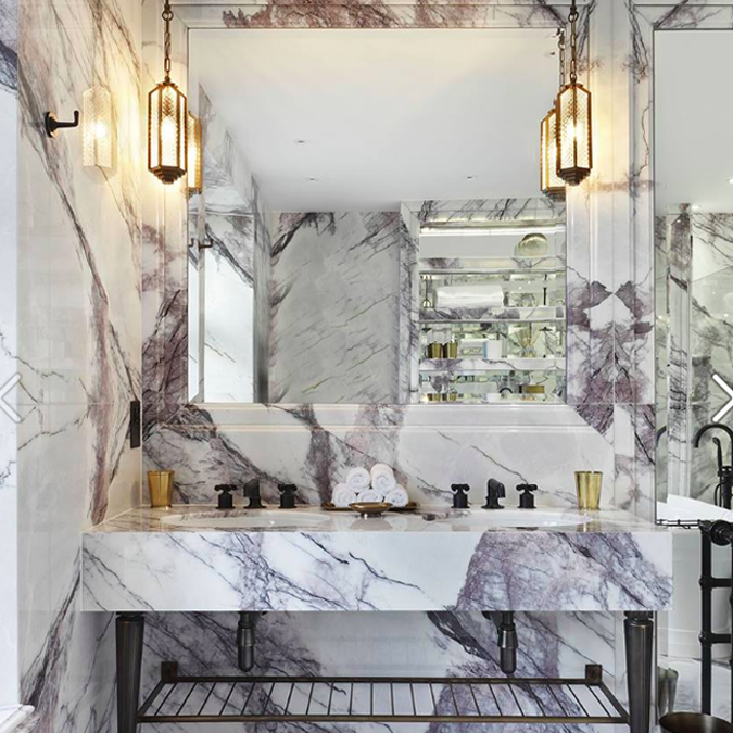 "A first look at one of the ""Dream Bathrooms"" in October @Homes & Gardens Magazine. Interior designer Rebecca James mixed Henry in architectural bronze with floor-to-ceiling marble. #ThePerfectBath"