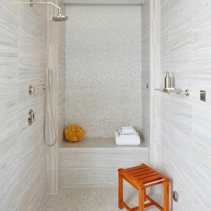 When a walk-in shower becomes a sanctuary. Our Keystone and Parramore tiles, Formwork fittings, Gotham towels and Teak stool in our LA showroom. #ThePerfectBath