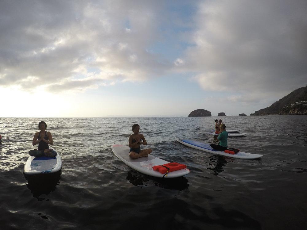 SUP yoga los arcos puerto vallarta mismaloya stand up paddleboard