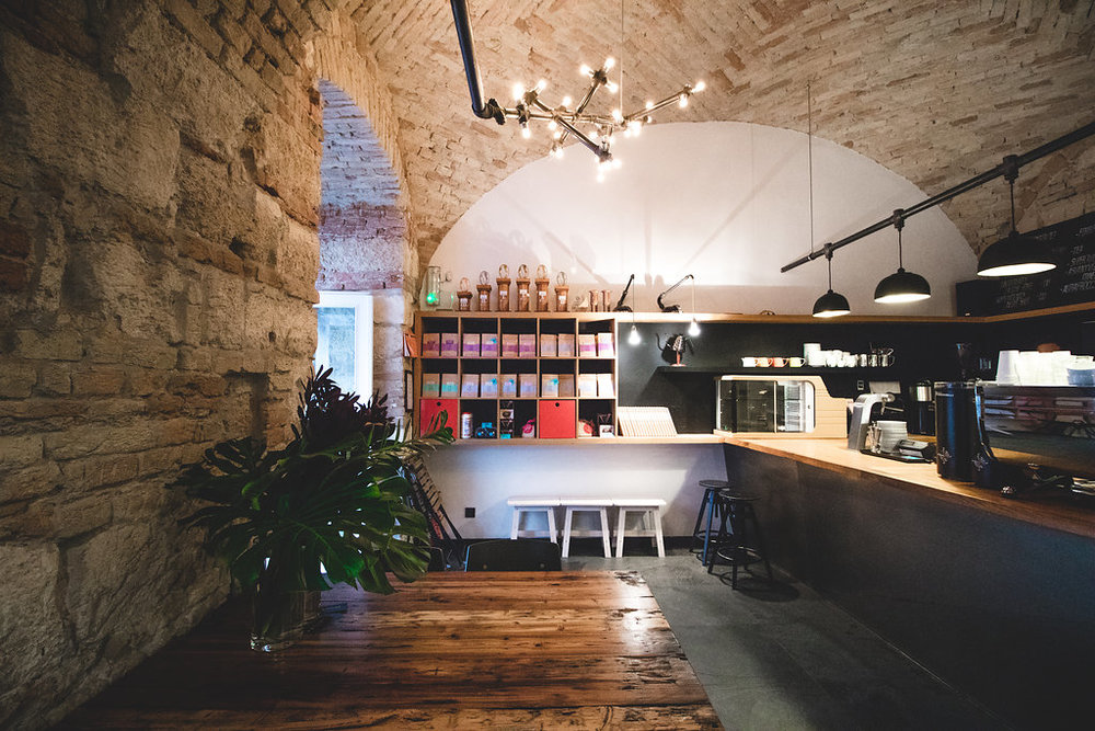 Espresso Embassy's restored vaulted brick ceilings are over 200 years old; the pioneering café is located in the heart of downtown Pest, in the basement of what was once a palatial private residence.  Photo by Nikolett Schreiber