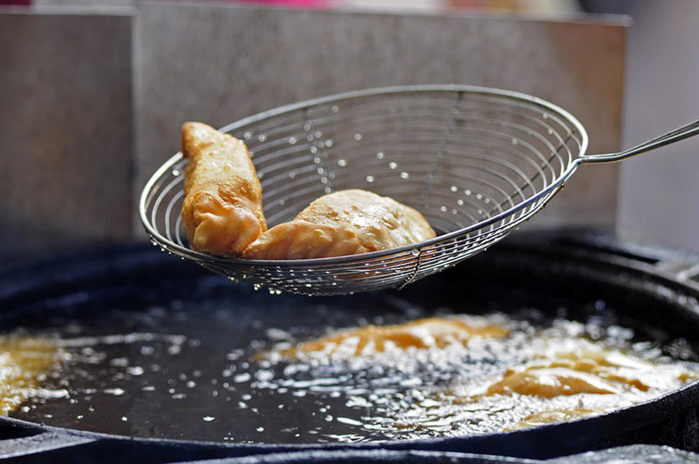We dare you to resist these sputtering-hot market empanadas.