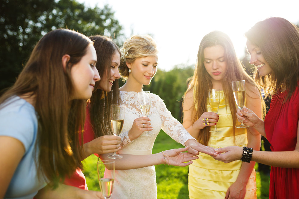 bride and female friends at outdoor reception.jpg