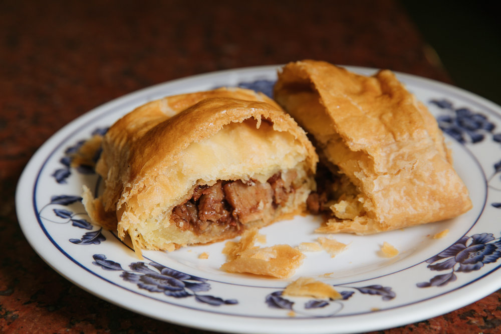 Pastry with a savory curried beef filling at AA Bakery & Cafe.