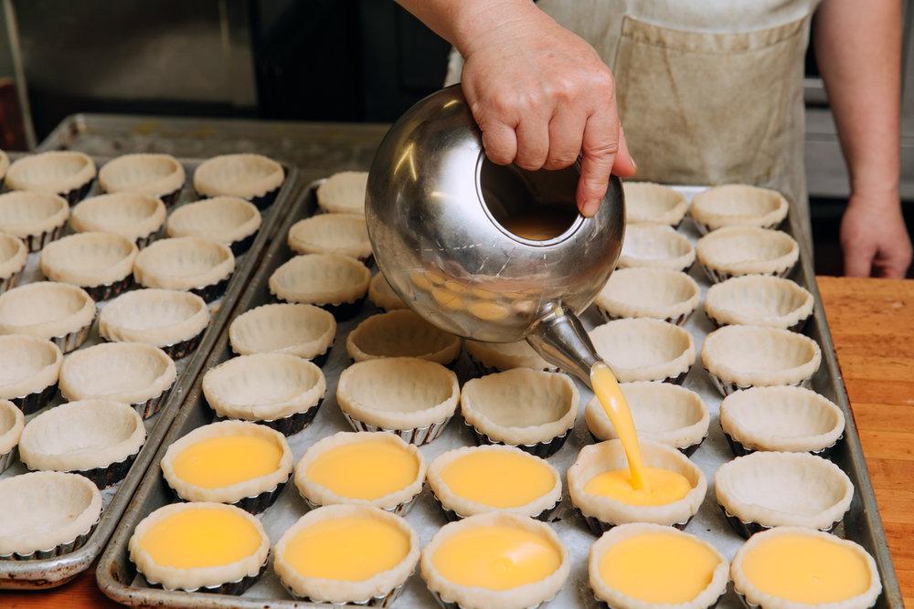 hundreds of dan tat (egg custard) made daily