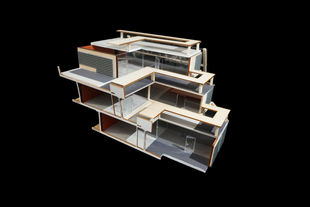 Model |   Model of the re-designed apartment complex that shows stacking of three units and their exterior spaces
