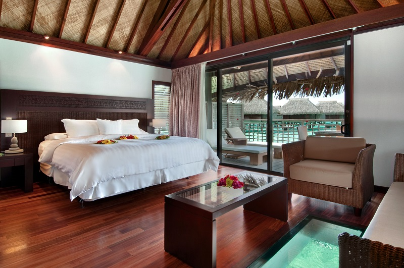 The luxurious rooms inside the overwater bungalows at the Hilton Moorea Lagoon Resort and Spa, one of the many in Tahiti and Bora Bora.