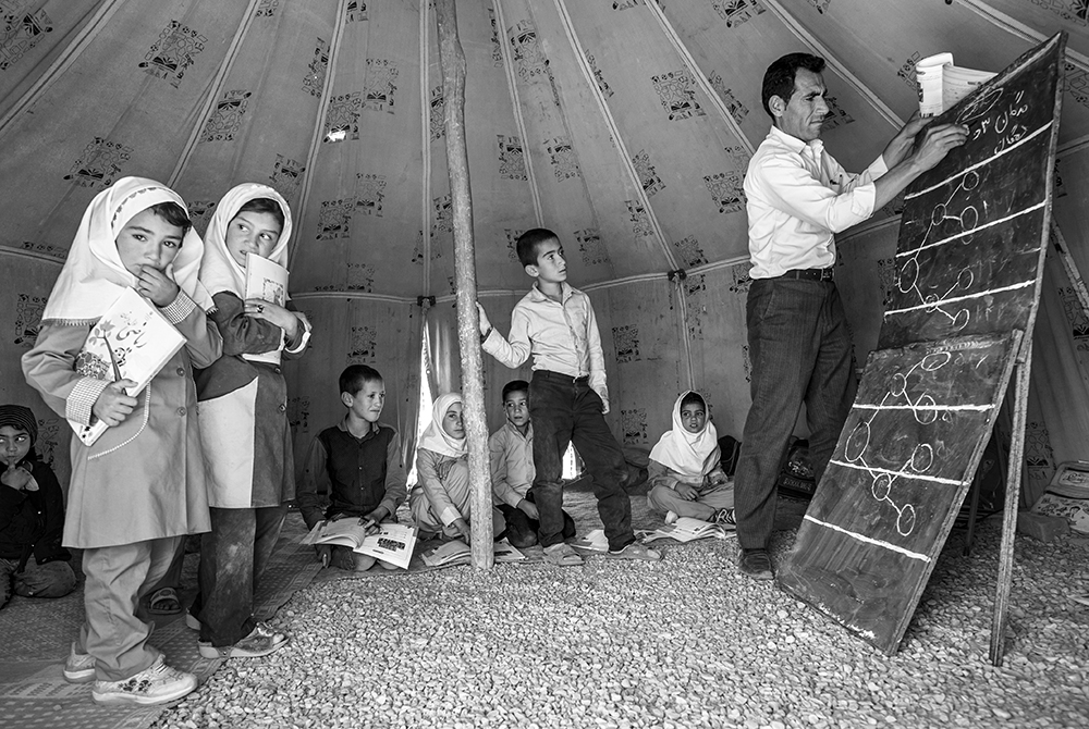 Yaghoubi Liaghat gives a class in a tent in southern Iran's Fars province. Photo: Valerie Leonard