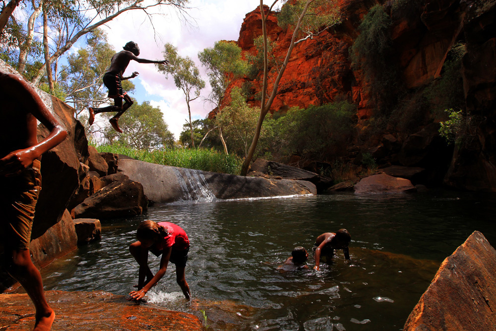 Children playing at a sacred watering hole in Australia's Northern Territory. Photo: Dean Sewell