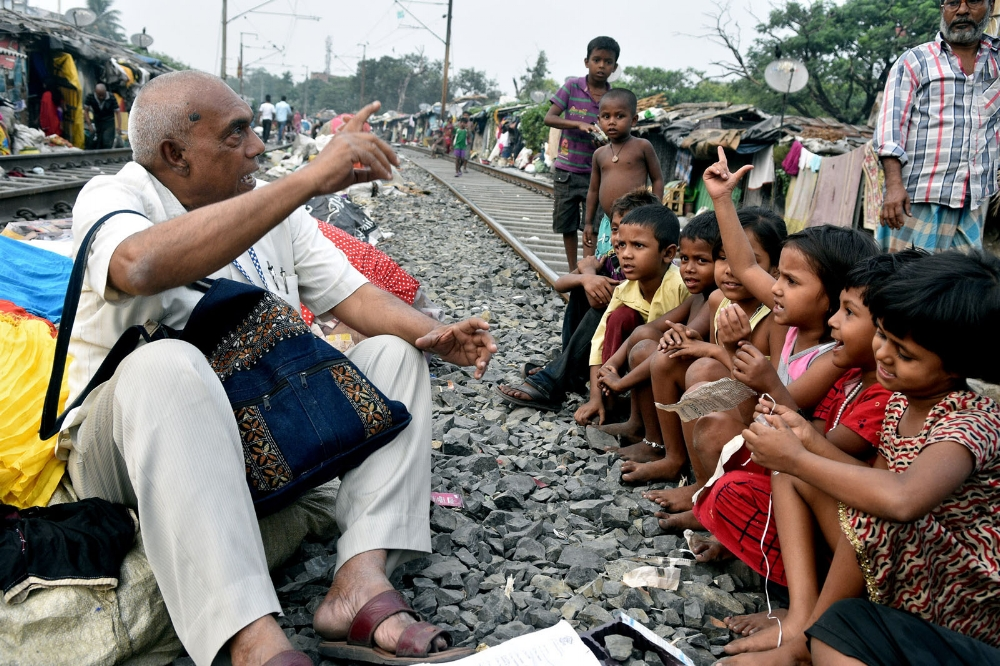 Mohd Alamgir gives a class by the track in a central Calcutta slum. Photo: Sudipto Das