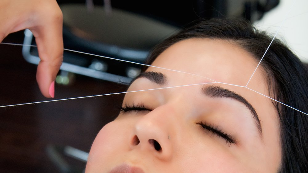 Threading An ancient Indian technique for removing facial hair; it is very delicate procedure, making it suitable for even the most sensitive skin. The art of threading may be seen in the gentle and precise twisting of a length of cotton thread which is twisted along the hairs which are to be removed. The twisting action of the thread traps the hair and lifts it out of the follicle.Threading is more effective and less painful than tweezing; hair re-growth becomes finer and more sparse after regular treatments; and the top layers of skin are not peeled or traumatized in the process.
