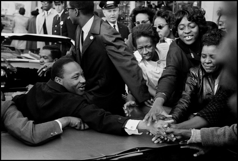 Dr. Martin Luther King Jr. being greeted on his return to the US after receiving the Nobel Peace Prize. Baltimore, Maryland, USA. October 31 1964.