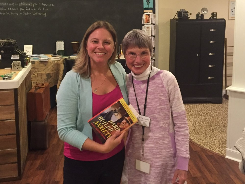 Stephanie poses with Karen Karydes and a copy of her new book, Hard Boiled Anxiety.