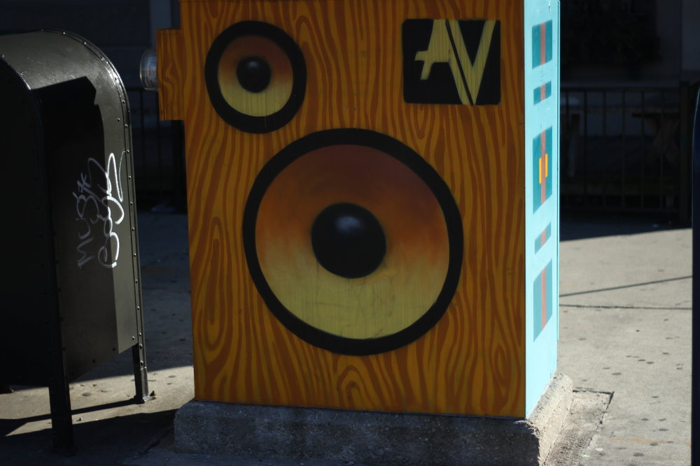 Most of the electrical boxes at intersections will have designs painted on them. (Artist Unknown.)
