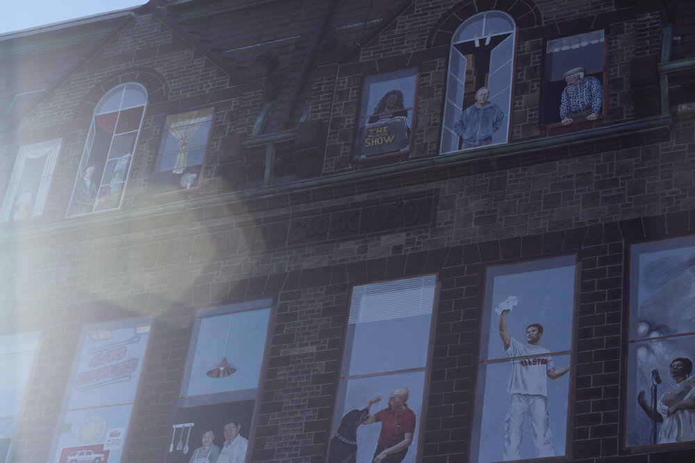 Painted residents of Allston greet the world from their faux windows.