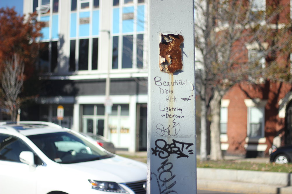 The poetic markings of a stranger on a light post.