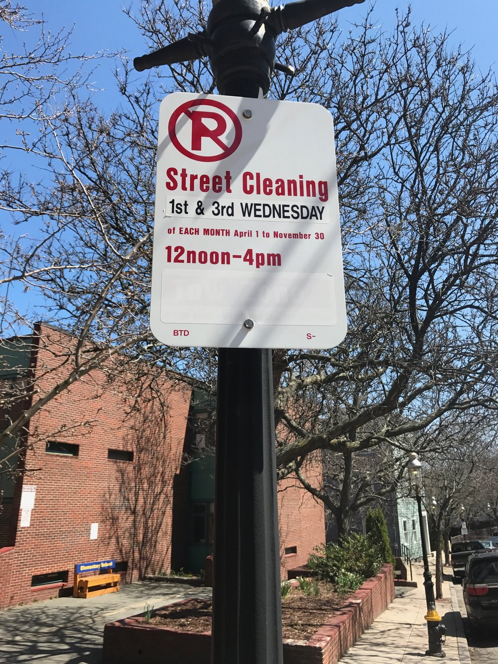 Street cleaning sign resident side of Charlestown