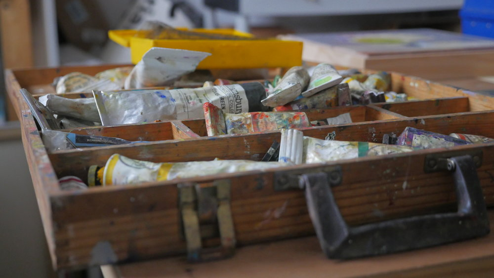One of Carol's many containers of oil paints, tools and materials.