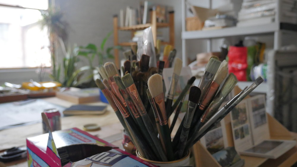 Carol's brushes, her studio space visible in the background.