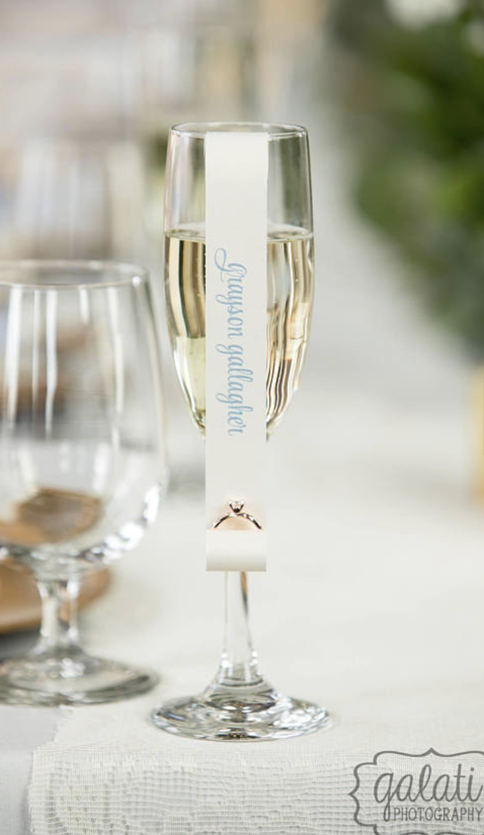 Double sided scroll place cards for champagne flutes