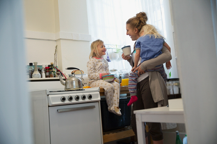 Mother and daughters in morning kitchen