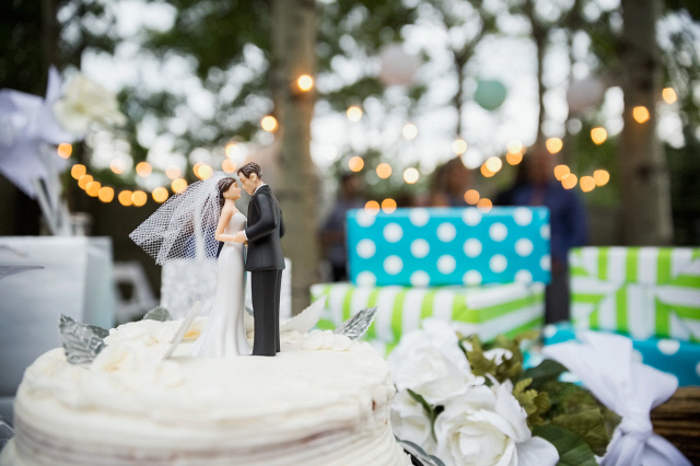 Bride and groom cake topper on cake