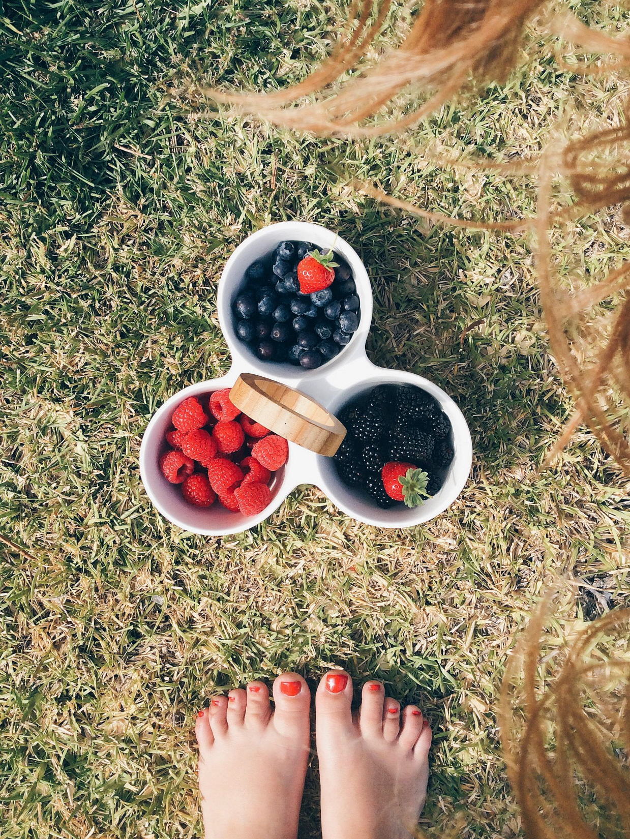 Female feet and basket full of berries